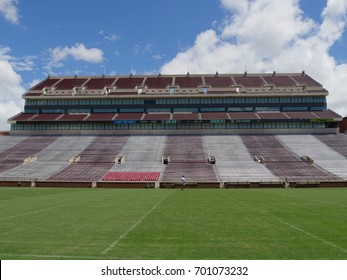 NORMAN, OKLAHOMA—Shot of the Gaylord Family Oklahoma Memorial Stadium at the University of Oklahoma bleachers taken in April 2017 against blue and white skies background