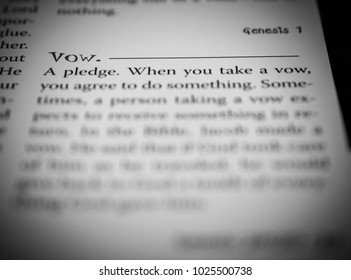 Norman, OK Feb. 15, 2018 The word: Vow defined in a religious dictionary. Selective focus on the word: Vow.