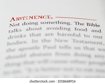 Norman, OK Feb. 4, 2018 The definition of the word: Abstinence in a religious dictionary. Selective focus on the word: Abstinence.