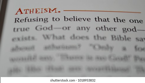 Norman, OK Feb. 4, 2018 The definition of the word: Atheism in a religious dictionary. Selective focus on the word: Atheism.