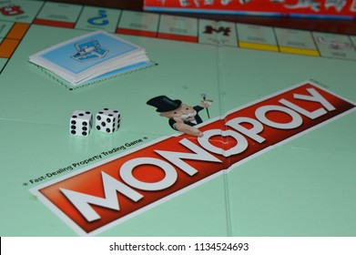 Norman, OK July 15, 2018 Close up photo of monopoly game board with two dice on top