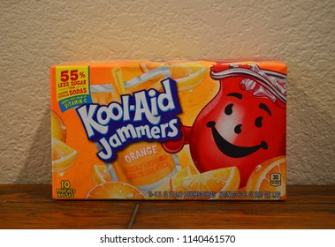 Norman, OK June 20, 2018 Close up photo of an Orange Kool-Aid Jammers box on a wooden table with a white background.