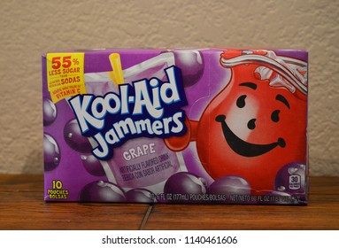 Norman, OK June 20, 2018 Close up photo of a purple Grape Kool-Aid Jammers box on a wooden table with a white background.