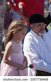 NORMAN, OKLAHOMA -  APRIL 01 2007: A little girl holding a red wooden rose in annual Medieval Fair event