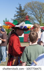 NORMAN, OKLAHOMA -  APRIL 01 2007: A man wearing medieval costume with hat and colorful feather in annual Medeval Fair event