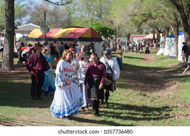 NORMAN, OKLAHOMA -  APRIL 01 2007: A group of men and women wear