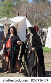 NORMAN, OKLAHOMA -  APRIL 01 2007: An old couple wearing black costume holding hands in annual Medieval Fair event