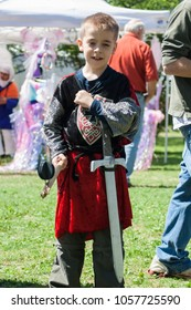 NORMAN, OKLAHOMA -  MARCH 31 2007: A boy wearing medieval costume with his club and sword in annual Medieval Fair event