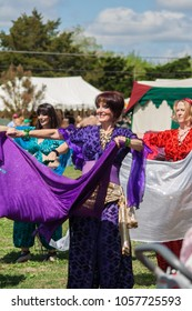 NORMAN, OKLAHOMA -  MARCH 31 2007: Women wearing medieval costume performing gypsy dance in annual Medieval Fair event