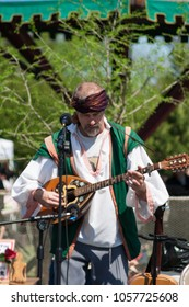 NORMAN, OKLAHOMA -  MARCH 31 2007: A man wearing medieval costume playing guitar in annual Medieval Fair event