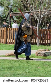 NORMAN, OKLAHOMA -  MARCH 31 2007: A man with medieval costume holding a stick in annual Medieval Fair event