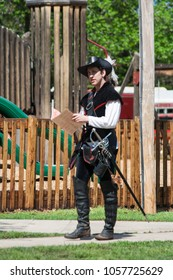 NORMAN, OKLAHOMA -  MARCH 31 2007: An young man wearing medieval costume in annual Medieval Fair event