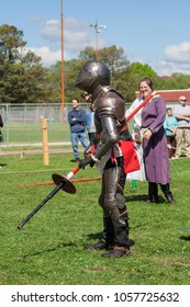 NORMAN, OKLAHOMA -  MARCH 31 2007: An armored knight holding a lance in annual Medieval Fair event