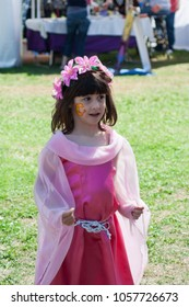 NORMAN, OKLAHOMA -  MARCH 31 2007: A little girl on pink fairy costume and flower headband in annual Medieval Fair event