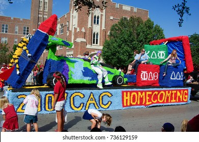 NORMAN, OKLAHOMA - OCTOBER 13 2007: A colorful float marches on street in homecoming event