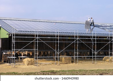 Normandie, France, January 2009. Renewable energy. Photovoltaic panel installation on the roof of a farm building