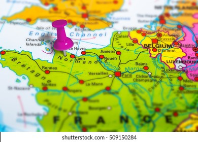 normandie in France pinned on colorful political map of Europe. Geopolitical school atlas. Tilt shift effect.