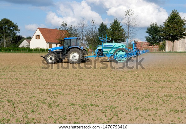 Normandie,  France, September 2007. Insecticide application with a spraying machine on a rapeseed field again rape stem weevil attack