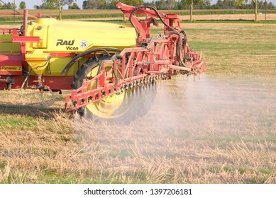 Normandie,  France, September 2007. Tractor spreading Round-Up (Glyphosate) on wheat straw with a spraying machine