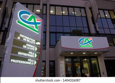 Normandy, Bois-Guillaume, France, April 2015. Regional headquarters of Crédit Agricole, french bank. Sign in the night