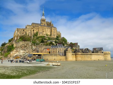 Normandy, France - 4/4/2017: Le Mont Saint-Michel is one of France's most popular and most recognized landmarks. Three million tourists visit each year. It's on the UNESCO list of World Heritage Sites