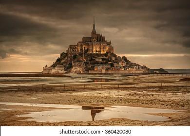Normandy, France: beautiful Mont Saint-Michel island at sunset.