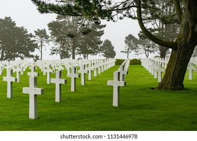 NORMANDY, FRANCE - June 12, 2018: White crosses of fallen soldiers of World War II in American Cemetery.