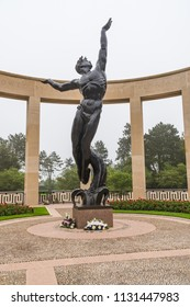NORMANDY, FRANCE - June 12, 2018: Statue erected at American Cemetery Memorial in Normandy in honor of the soldiers killed during the D-Day invasion in World War II.