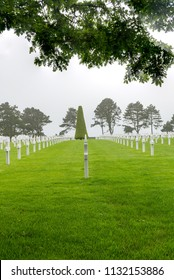 NORMANDY, FRANCE - June 12, 2018: White crosses of fallen soldiers of World War II in American Cemetery in Normandy, France