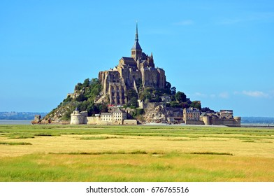 NORMANDY, FRANCE - JUNE 26, 2017: Mont-Saint-Michel is a Medieval fortress and situated one kilometer off the coast of Normandy.
