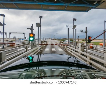 NORMANDY, FRANCE - MARCH 03 2018: Car passing the toll point Sandouville Normandy.