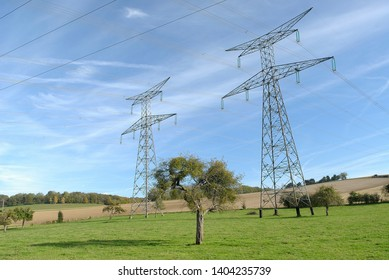 Normandy, France, November 2013. High-tension pylon on a meadow