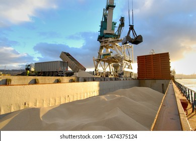 Normandy, Rouen, France, March 2015. Loading nitrogen fertilizers with crane on a barge on the river Seine in the port of Rouen in France.