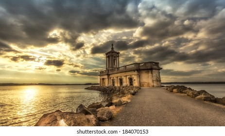 Normanton church museum in Rutland Water at sunset.