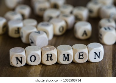 Norms written with wood cubes in german