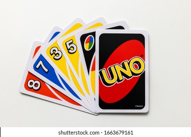 Luleå, Norrbotten/Sweden - February 29, 2020:  A hand of Uno card game cards, one card reversed. Uno was developed in 1971 by Merle Robbins in Reading, Ohio. Suited for all generations of players