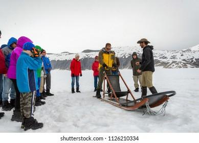 NORRIS GLACIER, ALASKA - JUN 2014:  A tour group getting prepared to dog sled on the Norris Glacier on June 23, 2014.