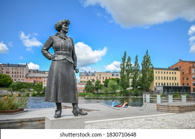NORRKOPING, SWEDEN - JULY 31, 2020: Statue by Pter Linde of author Moa Martinson in the famous industrial landscape of Norrkoping. Norrkoping is a historic industrial town in Sweden.