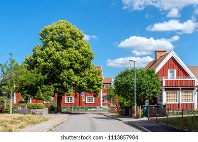 NORRKOPING, SWEDEN - JUNE 15, 2018: Vintage residential buildings in Red Town at the Marielund district of Norrkoping, Sweden. Red Town celebrates its centenary in 2018.