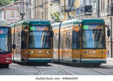 NORRKOPING, SWEDEN - JUNE 19: The iconic yellow trams of Norrkoping on June 19, 2016 in Norrkoping. Norrkoping is a historic industrial town in Sweden.