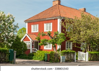 NORRKOPING, SWEDEN - MAY 21: Red city during spring on May 21, 2011 in Norrkoping. This is a picturesque residential area with old red wooden houses in the historic industrial town of Norrkoping.