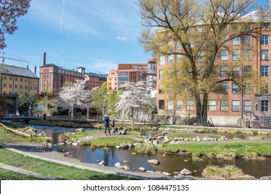 NORRKOPING, SWEDEN - MAY 5, 2018: Waterfront park Stromparken along Motala river in the center of Norrkoping. Norrkoping is a historic industrial town in Sweden