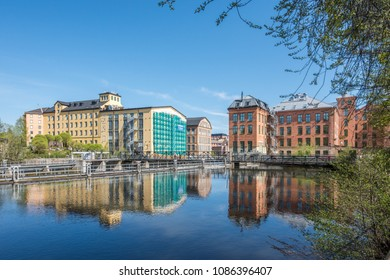 NORRKOPING, SWEDEN - MAY 7, 2018: Motala river and the old industrial landscape of Norrkoping during early spring. Norrkoping is a historic industrial town in Sweden.