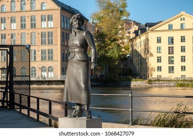 NORRKOPING, SWEDEN - OCTOBER 12, 2011: Statue of author Moa Martinson in the old industrial landscape. She was a famous author of proletarian literature and Norrkoping is a historic industrial town.