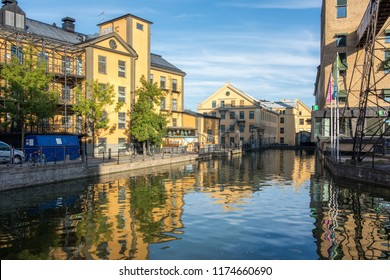 NORRKOPING, SWEDEN - SEPTEMBER 2, 2018: The old industrial landscape and Motala river on a quiet Sunday evening in Norrkoping. Norrkoping is a historic industrial town in Sweden.