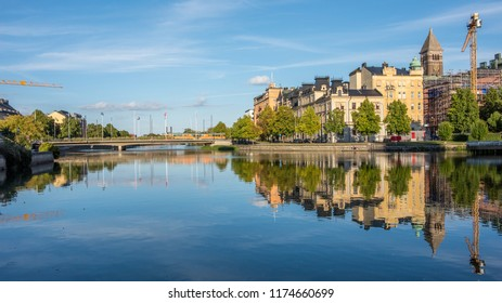 NORRKOPING, SWEDEN - SEPTEMBER 2, 2018: Norrköping waterfront and Motala river on a quiet Sunday evening in early September. Norrkoping is a historic industrial town in Sweden.