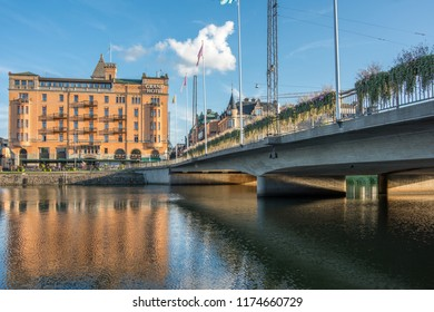 NORRKOPING, SWEDEN - SEPTEMBER 2, 2018: Norrköping waterfront and Saltangen bridge across Motala river on a quiet Sunday evening in early September. Norrkoping is a historic industrial town in Sweden.
