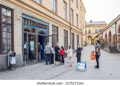 NORRKOPING, SWEDEN - SEPTEMBER 9, 2018: People queu at a polling place to give their vote on election day in Sweden. In the 2014 elections 85,8% of the population entitled to vote participated.