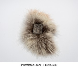 Norse rune Hagalaz (Hagal), isolated on fur and white background. Excitement, shake, exit the comfort zone. Getting rid of old unnecessary patterns. This rune is associated with Norse Goddess Hel.