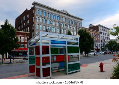 North Adams, MA - July 2 2017: A colorful, tinted bus shelter on Main Street